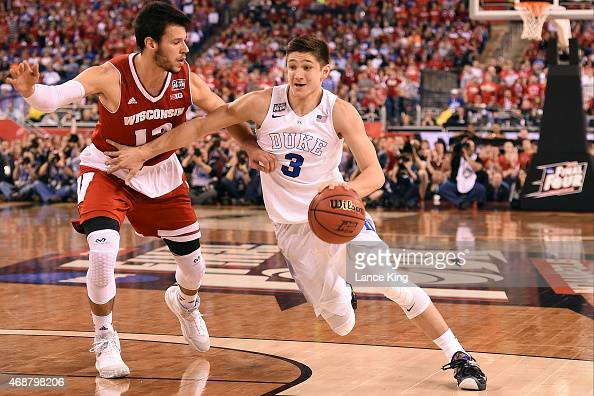 Grayson Allen of the Duke Blue Devils drives against Duje Dukan of the Wisconsin Badgers during the NCAA Men's Final Four Championship at Lucas Oil...