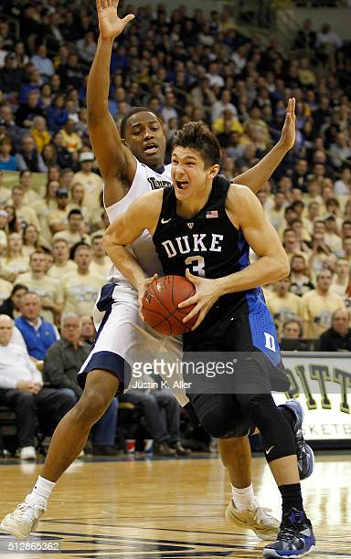 Grayson Allen of the Duke Blue Devils drives the lane against Chris Jones of the Pittsburgh Panthers during the game at Petersen Events Center on...