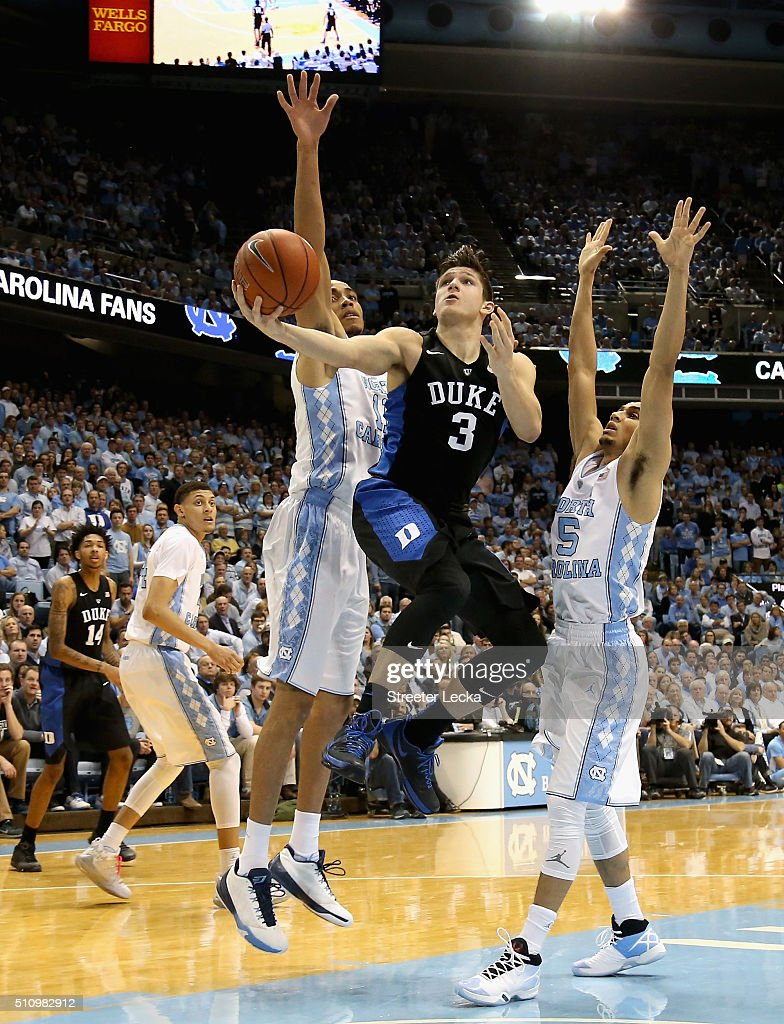Grayson Allen of the Duke Blue Devils drives to the basket against teammates Brice Johnson and Marcus Paige of the North Carolina Tar Heels during...