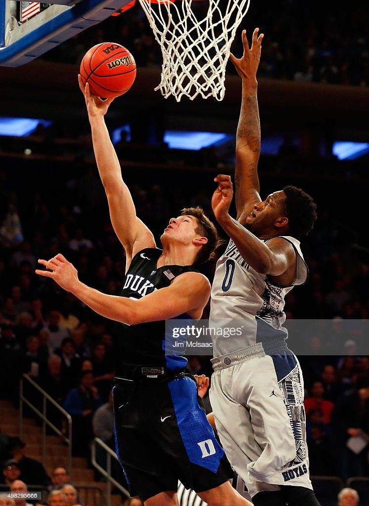 Grayson Allen of the Duke Blue Devils drives to the hoop in the first half against LJ Peak of the Georgetown Hoyas during the 2K Classic championship...