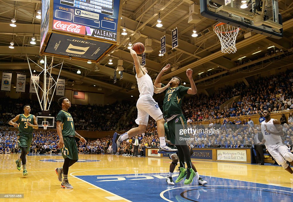 Grayson Allen of the Duke Blue Devils dunks over Javion Ogunyemi of the Siena Saints during their game at Cameron Indoor Stadium on November 13 2015...