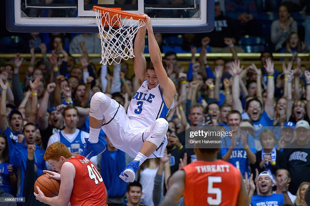 Grayson Allen of the Duke Blue Devils dunks over Kevin Degnan of the Fairfield Stags during their game at Cameron Indoor Stadium on November 15 2014...