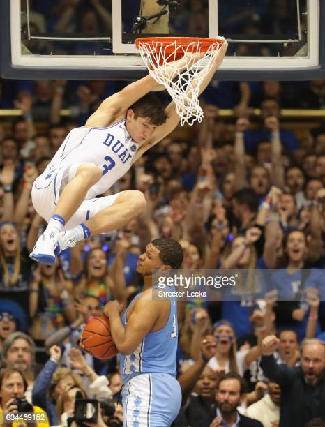 Grayson Allen of the Duke Blue Devils dunks the ball against Kennedy Meeks of the North Carolina Tar Heels during their game at Cameron Indoor...