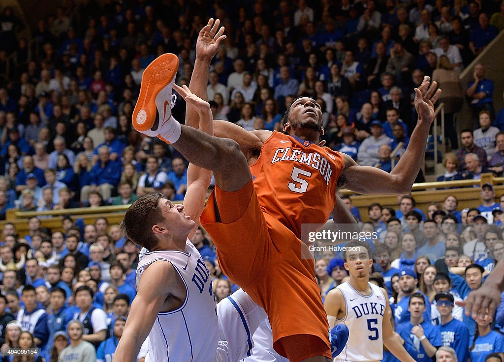 Grayson Allen of the Duke Blue Devils fouls Jaron Blossomgame of the Clemson Tigers as they collide during their game at Cameron Indoor Stadium on...