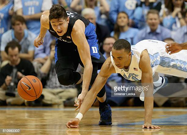 Grayson Allen of the Duke Blue Devils goes after a loose ball against Brice Johnson of the North Carolina Tar Heels during their game at Dean Smith...