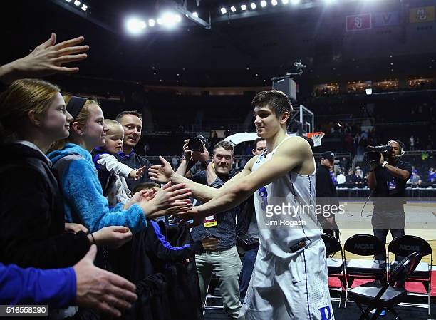 Grayson Allen of the Duke Blue Devils high fives fans after defeating the Yale Bulldogs 7164 during the second round of the 2016 NCAA Men's...