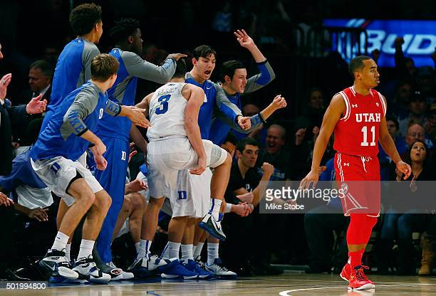 Grayson Allen of the Duke Blue Devils is mobbed by his teammaes after hitting a threepointer as Brandon Taylor of the Utah Utes looks on during the...