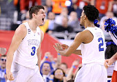 Grayson Allen of the Duke Blue Devils reacts after a play in the second half with Quinn Cook against the Wisconsin Badgers during the NCAA Men's...
