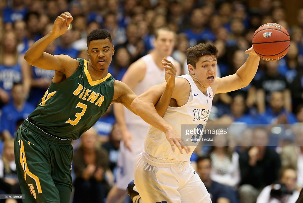 Grayson Allen of the Duke Blue Devils steals the ball from Ryan Oliver of the Siena Saints during their game at Cameron Indoor Stadium on November 13...