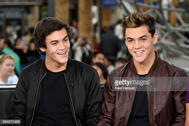 Grayson Dolan and Ethan Dolan visit 'Extra' at Universal Studios Hollywood on May 25 2016 in Universal City California