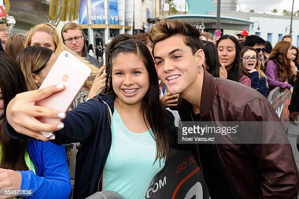 Grayson Dolan takes a selfie with a fan at 'Extra' at Universal Studios Hollywood on May 25 2016 in Universal City California