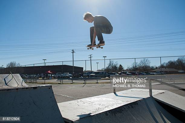 Grayson Goines a 20year old college student skates outside the McGee Community Center during the Super Tuesday primary voting on March 1 2016 in...