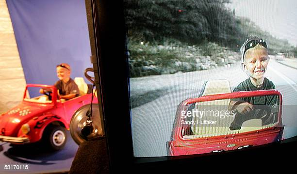 Grayson Johnson steers his buggy in front of a bluescreen background at a video booth at the San Diego County Fair June 29 2005 in Del Mar California...