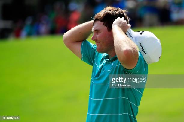 Grayson Murray of the United States celebrates after winning on the 18th green during the final round of the Barbasol Championship at the Robert...