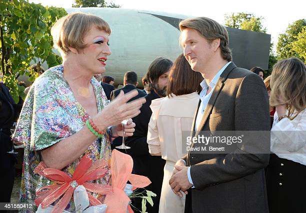 Grayson Perry and Tom Hooper attend The Serpentine Gallery Summer Party cohosted by Brioni at The Serpentine Gallery on July 1 2014 in London England