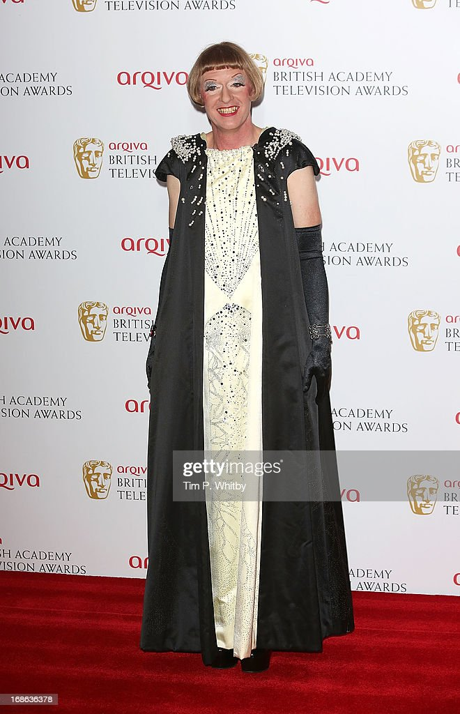 Grayson Perry poses in the press room at the Arqiva British Academy Television Awards 2013 at the Royal Festival Hall on May 12, 2013 in London, England.