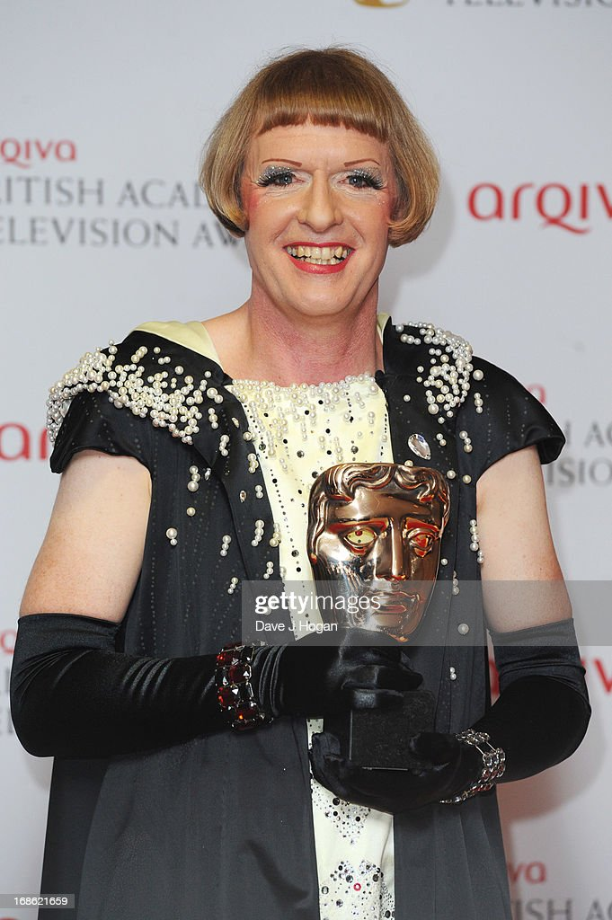 Grayson Perry poses with his Factual Series Award in front of the winners boards at the BAFTA TV Awards 2013 at The Royal Festival Hall on May 12, 2013 in London, England.