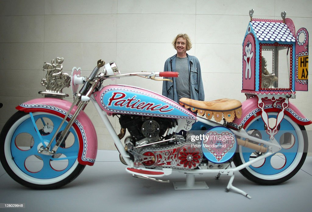 Grayson Perry stands with his 'Kenilworth AM1' customised motorbike at The Tomb of the Unknown Craftsman exhibition at the British Museum on October...