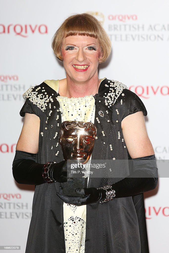 Grayson Perry with his Factual Series Award at the Arqiva British Academy Television Awards 2013 at the Royal Festival Hall on May 12, 2013 in London, England.