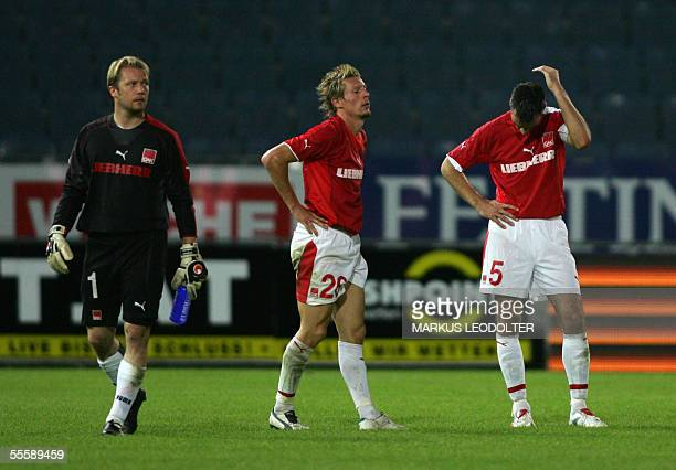 Andreas Schranz Gernot Plassnegger and Anton Ehmann are disappointed after their match in the UEFA CUP opposing them to Racing Strasbourg in Graz 15...