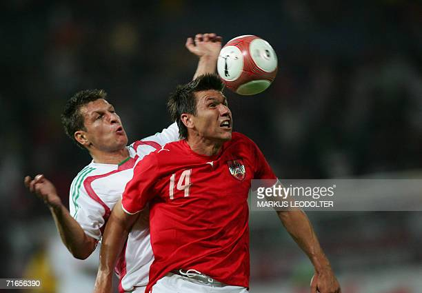 Austria's Markus Katzer challenges Hungary's Zoltan Kissfor a ball during their friendly football match in Graz 16 August 2006 AFP PHOTO Markus...