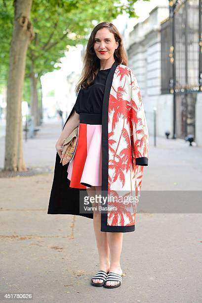 Grazia Germany fashion editor Stephanie Morcinek poses wearing a Fausto Puglisi coat and skirt and Adidas sliders before Atelier Versace show on July...