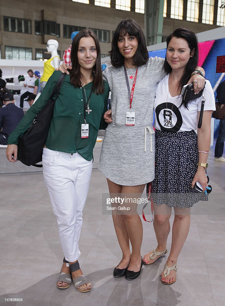 Grazia Germany reporters Christina Marie Faltings and Miriam Amro and adidas Originals employee Katrin Puka pose for a photo at the adidas Originals Spring/Summer 13 collection at the Bread and Butter 2012 fashion trade fair on July 4, 2012 in Berlin, Germany.