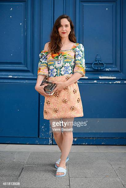 Grazia Germany's fashion editor Stephanie Morcinek poses wearing DG dress Sandro clutch and Adidas slides before Schiapparelli show on July 7 2014 in...