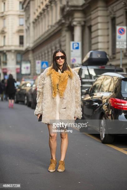Grazia IT girl Gilda Ambrosio wears a Prada Balenciaga Marcolin eyewear and Saint Laurent Paris shoes on Day 5 of Milan Fashion Week FW15 on March 1...