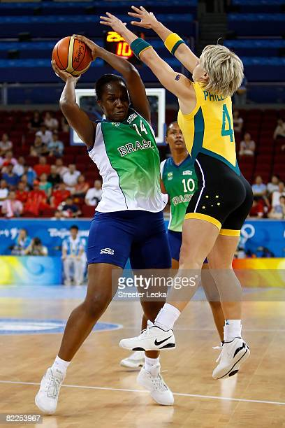 Graziane Coelho of Brazil looks to pass against Erin Phillips of Australia during their women's basketball game on Day 3 of the Beijing 2008 Olympic...