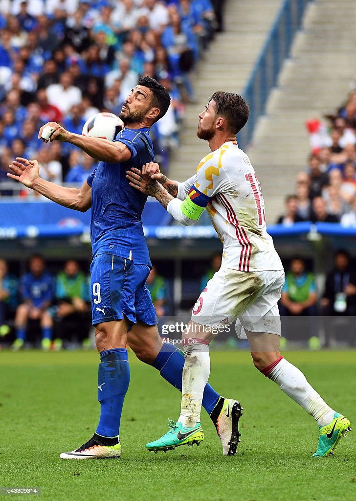 Graziano Pellè of Italy is challenged by Sergio Ramos of Spain during the UEFA EURO 2016 round of 16 match between Italy and Spain at Stade de France on June 27, 2016 in Paris, France.