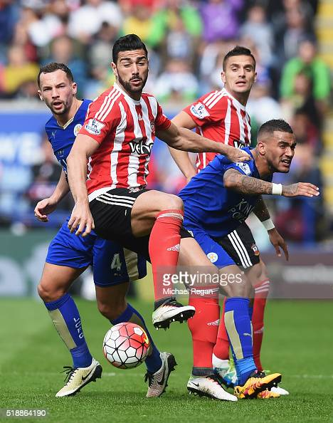 Graziano Pelle and Dusan Tadic of Southampton watch the ball with Danny Drinkwater and Danny Simpson of Leicester City during the Barclays Premier...