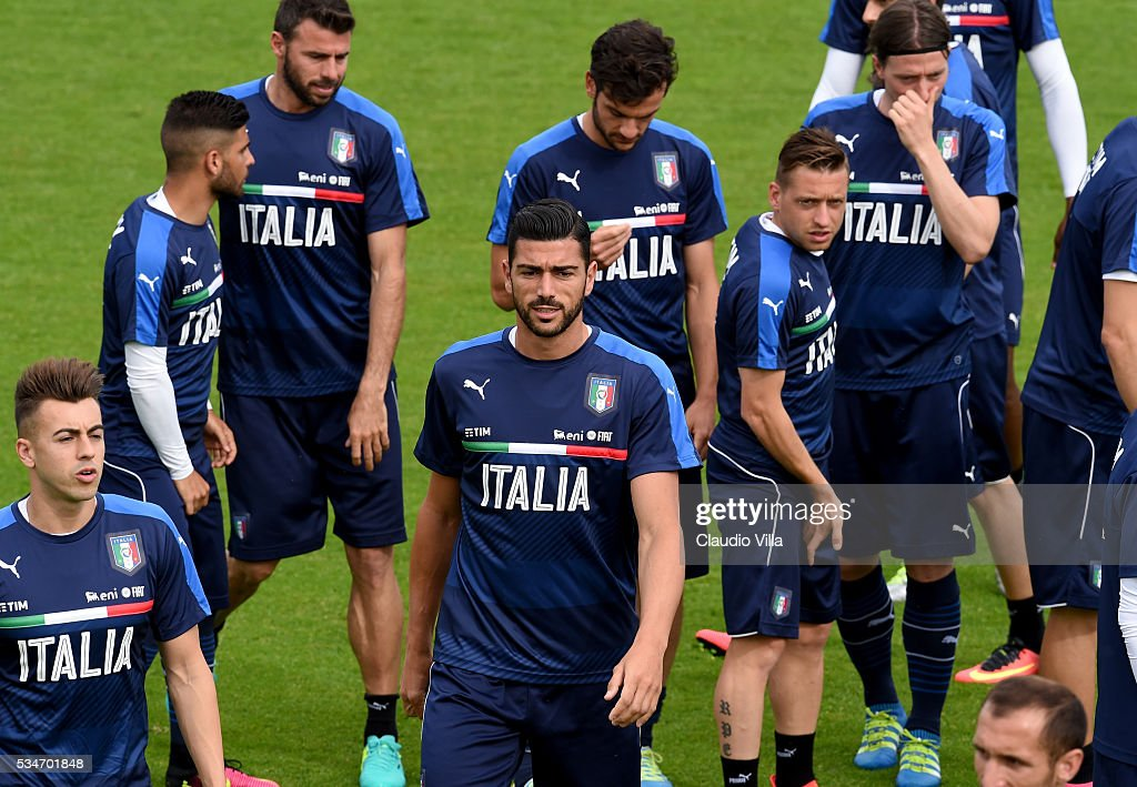 <a gi-track='captionPersonalityLinkClicked' href=/galleries/search?phrase=Graziano+Pelle&family=editorial&specificpeople=2333390 ng-click='$event.stopPropagation()'>Graziano Pelle</a> (C) looks on during the Italy training session at the club's training ground at Coverciano on May 27, 2016 in Florence, Italy.