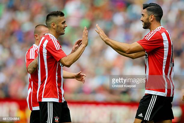Graziano Pelle of FC Southampton celebrates the third goal with Dusan Tadic of FC Southampton during the friendly match between FC Groningen and FC...