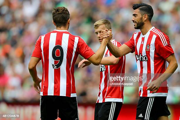 Graziano Pelle of FC Southampton celebrates the third goal with Jay Rodriguez of FC Southampton during the friendly match between FC Groningen and FC...