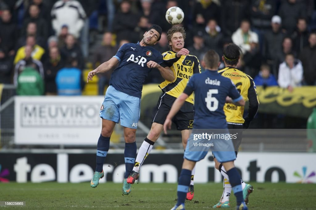 Graziano Pelle of Feyenoord, Kees Luijckx of NAC Breda, Jordy Clasie of Feyenoord, <a gi-track='captionPersonalityLinkClicked' href=/galleries/search?phrase=Nemanja+Gudelj&family=editorial&specificpeople=7480325 ng-click='$event.stopPropagation()'>Nemanja Gudelj</a> of NAC Breda during the Dutch Eredivisie match between NAC Breda and Feyenoord at the Rat Verlegh Stadium on December 09, 2012 in Breda, The Netherlands.