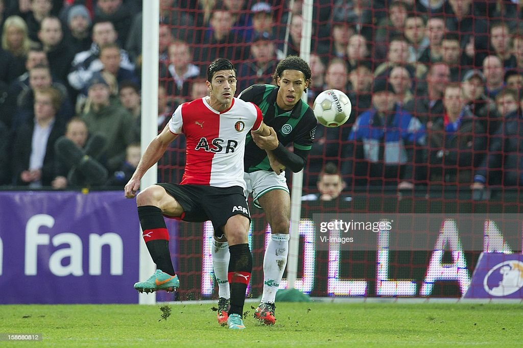 Graziano Pelle of Feyenoord, Virgil van Dijk of FC Groningen during the Dutch Eredivise match between Feyenoord and FC Groningen at stadium De Kuip on December 23, 2012 in Rotterdam, The Netherlands.