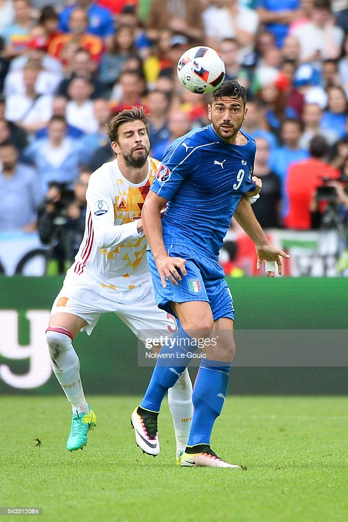 Graziano Pelle of Italy and Gerard Pique of Spain during the European Championship match Round of 16 between Italy and Spain at Stade de France on June 27, 2016 in Paris, France.
