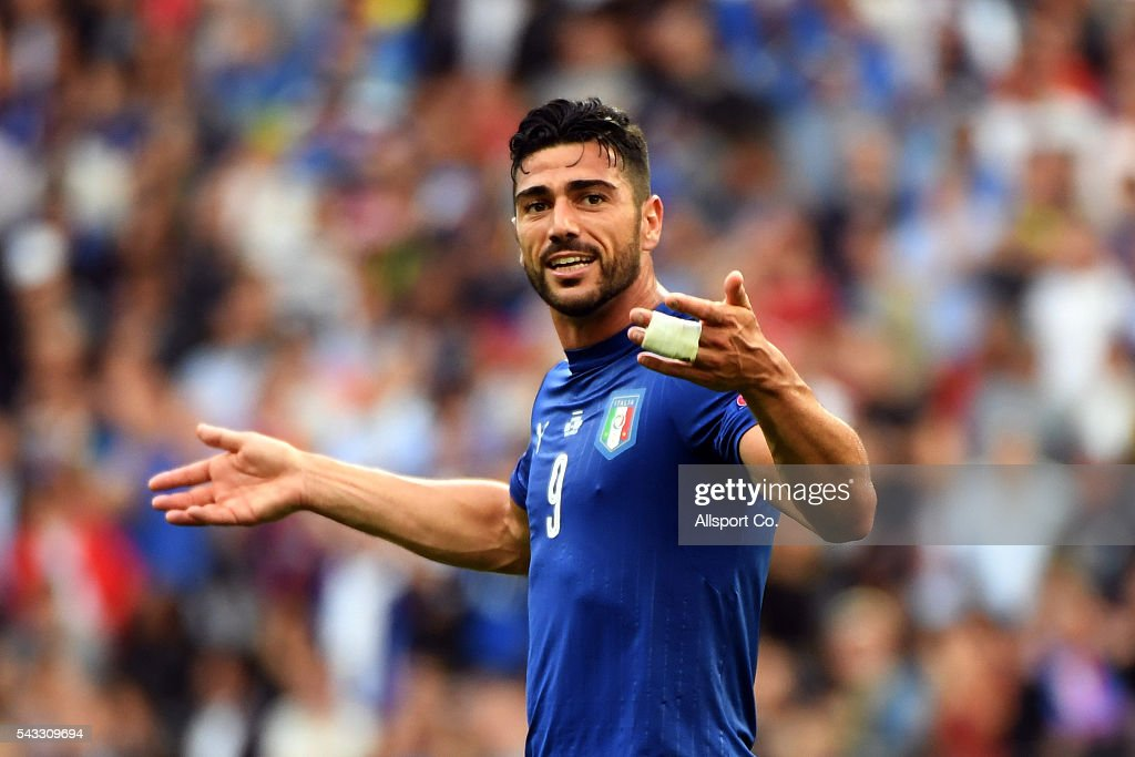 <a gi-track='captionPersonalityLinkClicked' href=/galleries/search?phrase=Graziano+Pelle&family=editorial&specificpeople=2333390 ng-click='$event.stopPropagation()'>Graziano Pelle</a> of Italy celebrates after they defeated Spain during the UEFA EURO 2016 round of 16 match between Italy and Spain at Stade de France on June 27, 2016 in Paris, France.