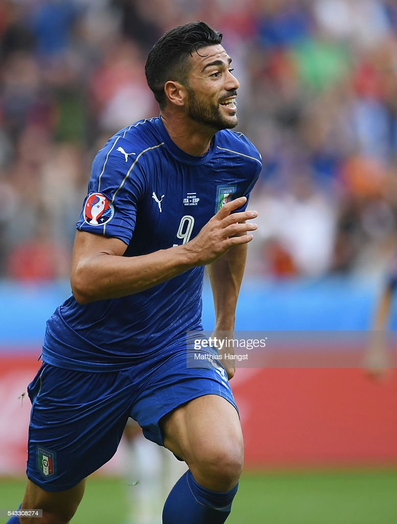 <a gi-track='captionPersonalityLinkClicked' href=/galleries/search?phrase=Graziano+Pelle&family=editorial&specificpeople=2333390 ng-click='$event.stopPropagation()'>Graziano Pelle</a> of Italy celebrates scoring his team's second goal during the UEFA EURO 2016 round of 16 match between Italy and Spain at Stade de France on June 27, 2016 in Paris, France.