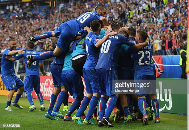 Graziano Pelle of Italy celebrates scoring his team's second goal with his team mates during the UEFA EURO 2016 round of 16 match between Italy and...
