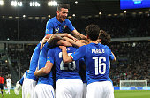 Graziano Pelle of Italy celebrates with his teammates after scoring the opening goal during the international friendly match match between Italy and...