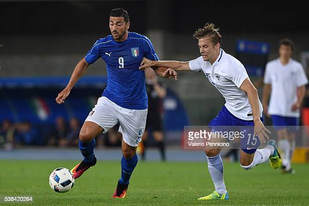 Graziano Pelle of Italy is challenged by Markus Halsti of Finland during the international friendly match between Italy and Finland on June 6 2016 in...