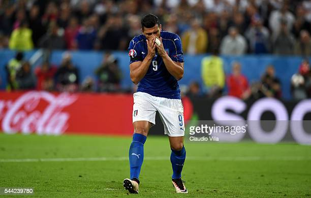 Graziano Pelle of Italy reacts after missing at the penalty shootout during the UEFA EURO 2016 quarter final match between Germany and Italy at Stade...