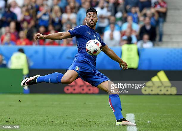 Graziano Pelle of Italy scores his team's second goal during the UEFA EURO 2016 round of 16 match between Italy and Spain at Stade de France on June...
