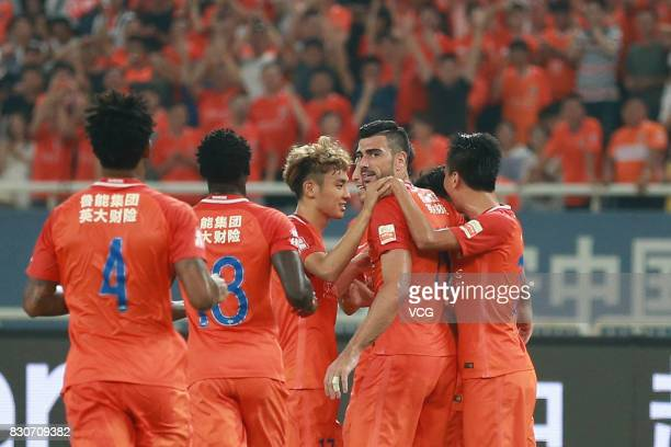 Graziano Pelle of Shandong Luneng celebrates a point with teammates during the 22nd round match of 2017 Chinese Football Association Super League...
