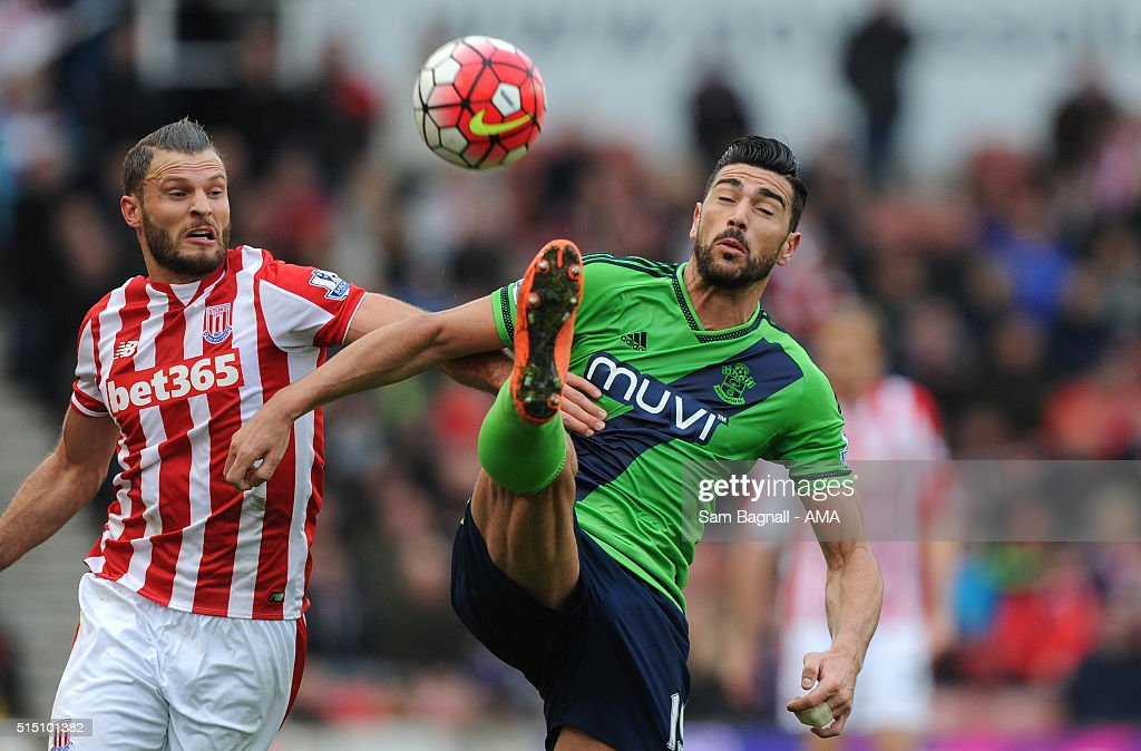Graziano Pelle of Southampton and Erik Pieters of Stoke City during the Barclays Premier League match between Stoke City and Southampton at Britannia Stadium on March 12, 2016 in Stoke on Trent, England.