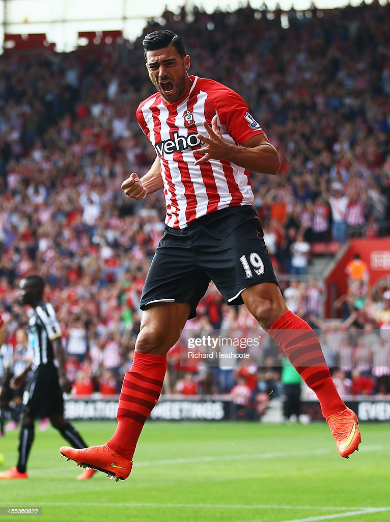 <a gi-track='captionPersonalityLinkClicked' href=/galleries/search?phrase=Graziano+Pelle&family=editorial&specificpeople=2333390 ng-click='$event.stopPropagation()'>Graziano Pelle</a> of Southampton celebrates as he scores their first goal during the Barclays Premier League match between Southampton and Newcastle United at St Mary's Stadium on September 13, 2014 in Southampton, England.