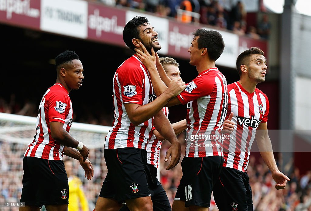 Graziano Pelle of Southampton celebrates scoring his team's third goal with team mates during the Barclays Premier League match between West Ham United and Southampton at Boleyn Ground on August 30, 2014 in London, England.