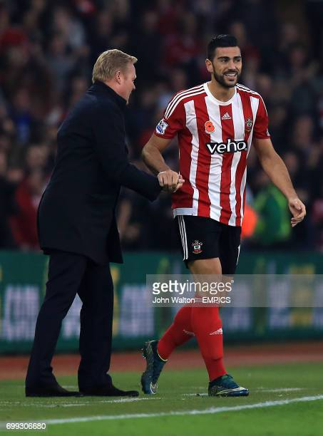 Graziano Pelle of Southampton celebrates with Southampton manager Ronald Koeman after scoring his sides second goal of the game